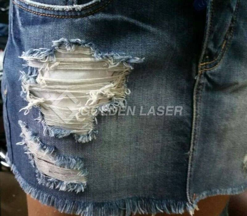 Torn damage cut design on Jeans